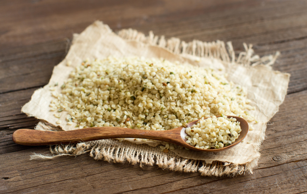 Uncooked Hemp seeds with a spoon